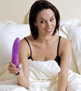 Frau mit ihrem Vibrator