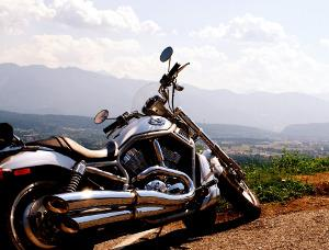 Bild Motorrad vor Berglandschaft
