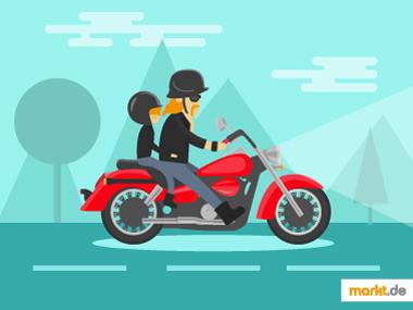 Bild rotes Motorrad mit Mann und Kind