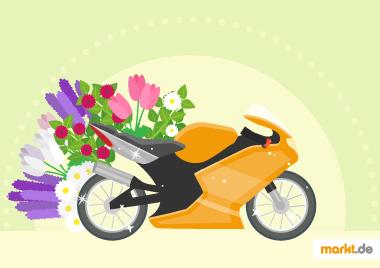 Bild oranges Motorrad mit bunten Blumen